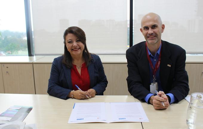 Durante la firma de la Carta de Coordinación entre UNFPA y Plan Internacional